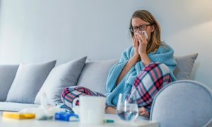 Woman Sneezing On Couch